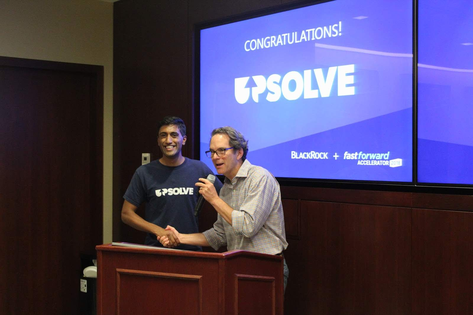 Upsolve's Rohan Pavuluri accepts the BlackRock Employee Award from Jody Kochansky
